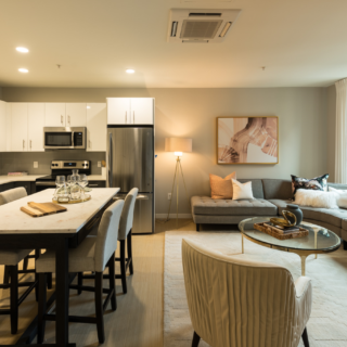 Spacious model kitchen with white cabinets and stainless appliances in Old City apartments