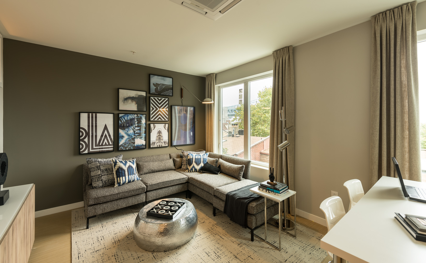Open concept living room with hardwood floors and wonderful view of city in Old City apartment rentals