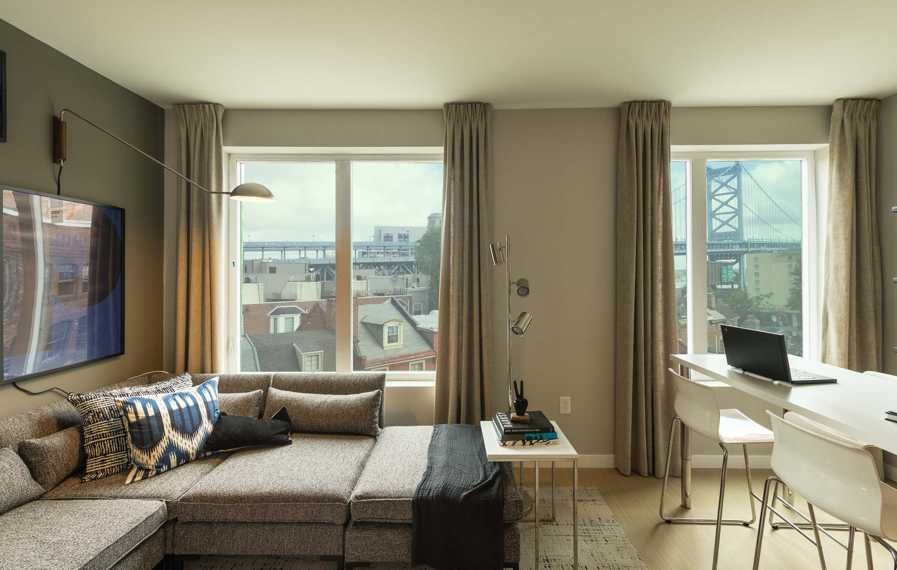 Splendid The National living room with hardwood flooring and luxurious features in Old City apartment rentals