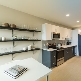 Open-concept kitchen and dining room space in The National's Old City apartments