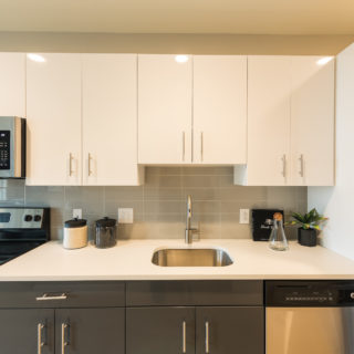 Fantastic kitchen with stainless steel appliances and bright white cabinets in Old City apartment rental homes