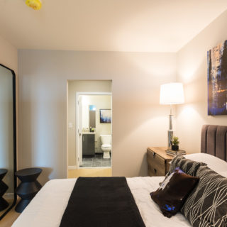 Master bedroom with carpeted flooring and private bathroom in Old City apartments for rent