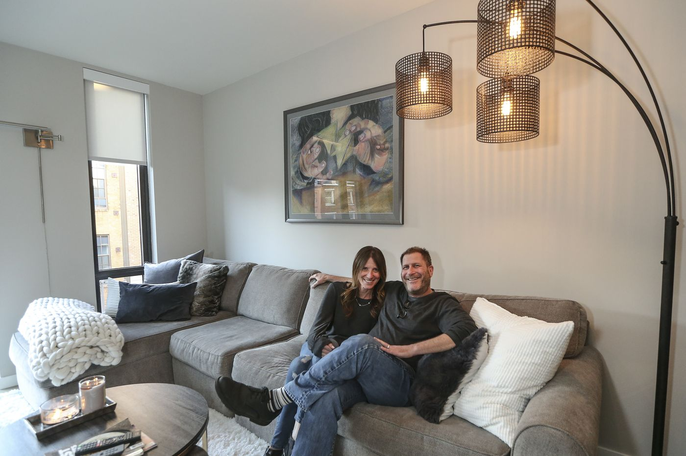 Couple inside apartment home at The National in Old City