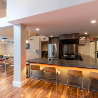 Communal kitchen in The National two-story resident clubhouse with spacious seating options in Old City apartments