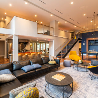 Communal clubhouse area with large TV and comfortable seating in The National apartments for rent in Old City