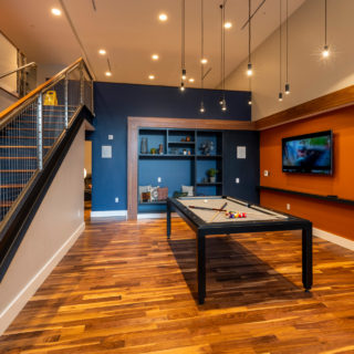 Pool table, television and communal seats in The National's resident clubhouse in Old City