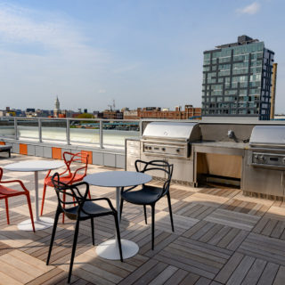 The National rooftop with comfortable seating and two professional BBQ grills in Old City apartment homes for rent